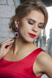 Model in red party dress with diamond accessories Royalty Free Stock Images