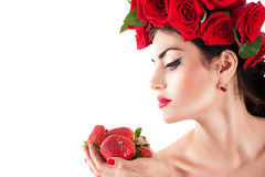 Model with red roses hairstyle Stock Image