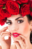 Model with red roses hairstyle Stock Photo