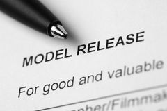 Model release. Close-up of black pen on the model release blank Royalty Free Stock Photo