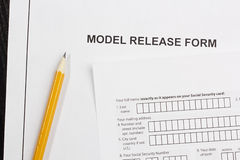 Model Release Form. Directly above photograph of a model release form Stock Photos