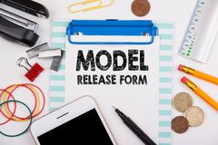 Model Release Form concept. Office desk with stationery. And mobile phone stock photography