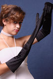 Model removing her glove Stock Photo