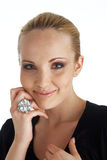 Model With A Ring. Close-up portrait of a blond model, smiling and holding a hand under her cheek Stock Images