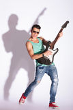 Model rocking on a guitar Stock Image