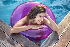 Model in rubber ring in swimming pool Royalty Free Stock Photos