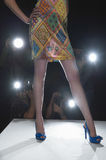Model's Legs On Catwalk With Cameras Flashes Stock Image