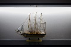 Model Sailboat Frigate Sitting on Display Shelf Lights Black White Elegant Decoration Centered stock image
