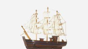 Model sailboat on white background. stock video