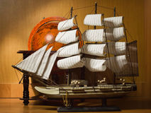 Model Sailing Ship And Old Globe Royalty Free Stock Image
