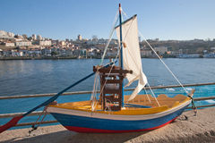 Model of a sailing ship. Handmade sailboat. Souvenir production. Walk along the seafront of Porto Royalty Free Stock Photo