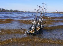 Model of sailing ship swimming in river Stock Photo