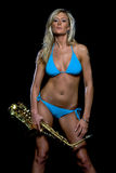Model with a Saxaphone. A blond model holding a saxophone against a black background Stock Photo