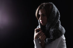 Model with Scarf on Head Looking at Light royalty free stock photos