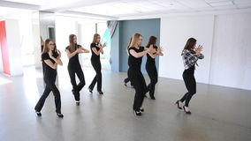 In model school young females are dancing. stock footage