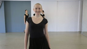 In model school young females are walking from different sides stock video footage