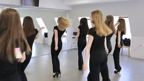 In model school young women are dancing. stock footage