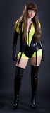 Model in yellow and black outfi. T with thigh high boots and garter stock image