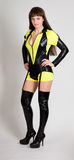 Model in yellow and black outfit. With thigh high boots and garter royalty free stock photo