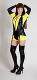 Model in yellow and black outfit. With thigh high boots and garter royalty free stock photos