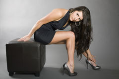 Model shapes. Model in mini dress creates a great look with legs and body Stock Photo
