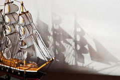 Model of the ship. Model of the wooden ship with shadow on the wall Royalty Free Stock Images