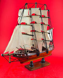 Model ship. The model ship on a red background Royalty Free Stock Image