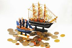 Model ships and coins Stock Image