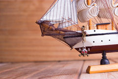 Model of ships on the wooden table. Travel concept Royalty Free Stock Photos