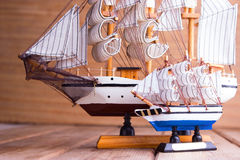 Model of ships on the wooden table. Travel concept Stock Photos