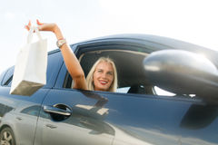 Model with shopping in car. Photo of model with shopping in car on summer day Royalty Free Stock Images