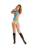 Model in short catsuit and high boots, rear view Royalty Free Stock Images