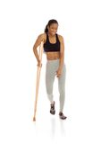 Model shot in studio on white injured with crutch Stock Photography
