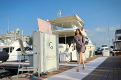 Model showcasing designs by Skin Resort Fashion at the Singapore Yacht Show 2013 Stock Images
