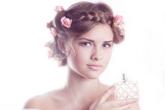 Model showing a fragrance bottle Royalty Free Stock Photo