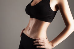 Model showing her slim stomach Stock Image
