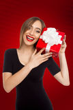 Model showing red box with surprise Royalty Free Stock Photography