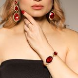 Model shows decoration from the spring collection jewelery and accessory. Model shows earrings decoration from the spring collection jewelery and accessory Royalty Free Stock Photography