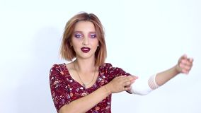 The model shows a sore arm. On a white background stock footage