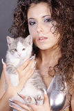 Model in silver with cats Stock Photos