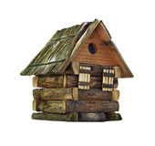 Model of simple village wooden log house isolated on white. Background. Toy decorative house made from rustic hardwood Stock Photo