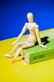 Model sit on the Bible. Royalty Free Stock Photo