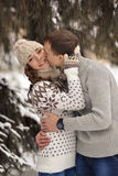 Man kiss her woman.Boy kiss her girl on cheek in the winter forest.True love. Royalty Free Stock Images
