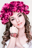 Fashionable,glamorous,unreal beautiful,attractive model,girl with wreath with rose,red flowers,white,pale skin,creative make-up. Stock Photos