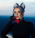 Sexual portrait of seductive,sexual girl.Professional fashionable model on fashion week. Well-dressed, good-looking girl,woman cat Stock Photos