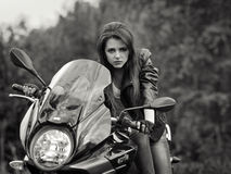 Serious,fashionable,risky biker girl,biker with dangerous look.Motorbike Royalty Free Stock Photos