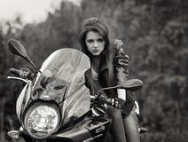 Serious,fashionable,risky biker girl,biker with dangerous look.Motorbike Royalty Free Stock Photos