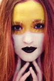 Beautiful girl with creative makeup,painting art.Yellow and white colors with black lips.Perfect,amazing,beautiful,expressive eyes Stock Photography