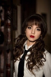 Sexual,seductive,attractive,excellent,perfect student,school girl,teacher with beautiful make-up,red lips,wavy,curly hair in bar. Royalty Free Stock Image