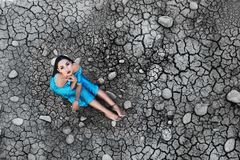 The model sits on the dried soil Stock Photo